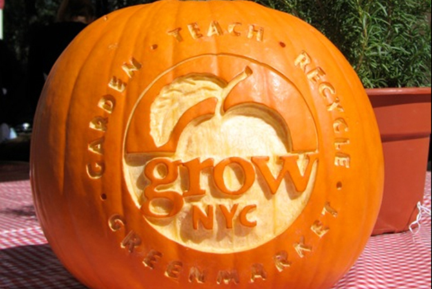 New GrowNYC logo, carved into a pumpkin at the Greenmarket